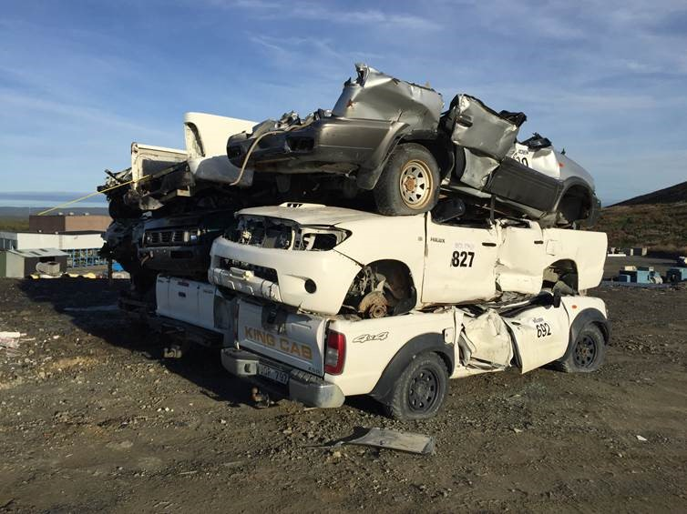 Big trucks deliberately drive over end-of-life Hilux
