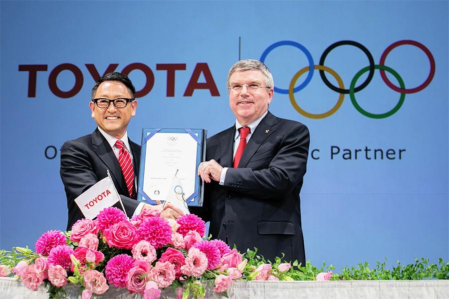 Toyota President Akio Toyoda and IOC President Thomas Bach