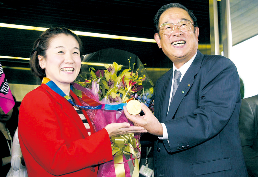 Former president Cho with Judo gold medalist Ryoko Tani, Toyota employee at that time