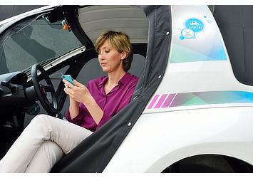 """Toyota COMS at a charging station for """"Cité lib by Ha:mo"""" EV sharing trial in Grenoble, France"""
