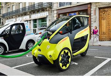 "Toyota i-ROAD and COMS at a charging station for ""Cité lib by Ha:mo"" EV sharing trial in Grenoble, France"