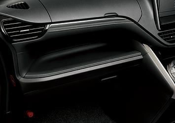 Large open tray on the passenger side (upholstered in synthetic leather)
