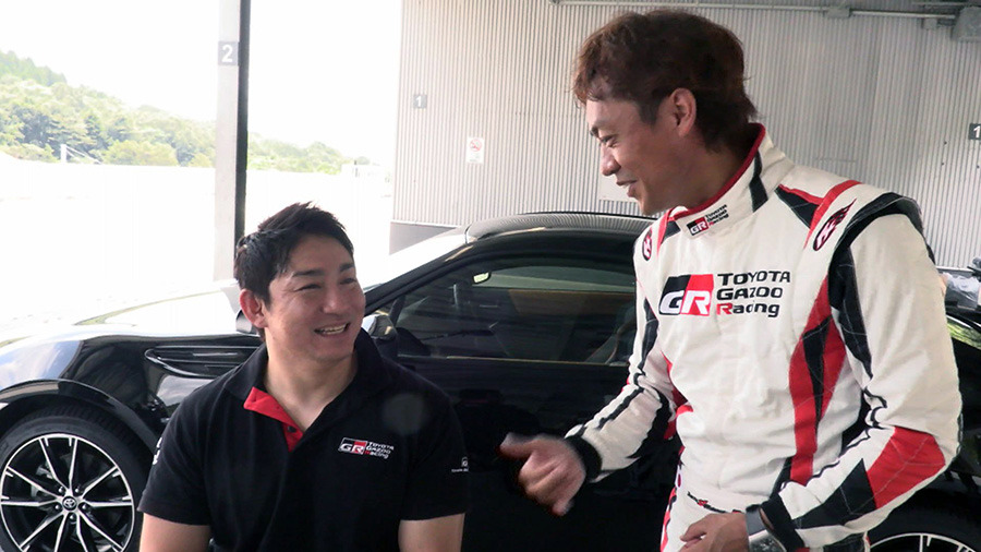 Racing Driver Juichi Wakisaka takes Morii on a ride at Fuji Speedway