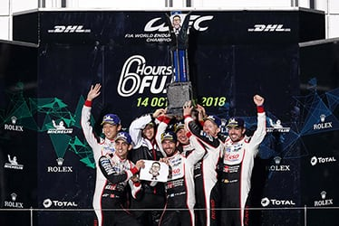 Kazuki Nakajima / Sébastien Buemi, driver / Shigeki Tomoyama, GAZOO Racing Company President / José María López / Kamui Kobayashi / Mike Conway / Fernando Alonso, driver; 2018-19 WEC Round 4 Fuji
