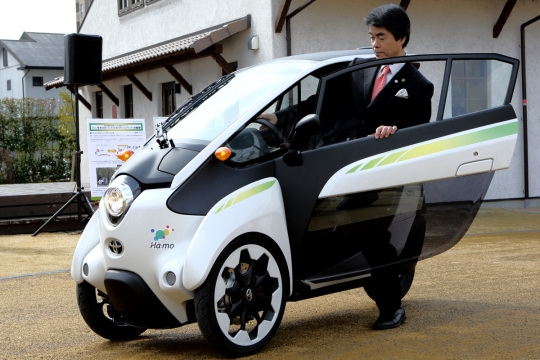 Toshihiko Ota, mayor of Toyota City, takes a spin in a Toyota i-Road